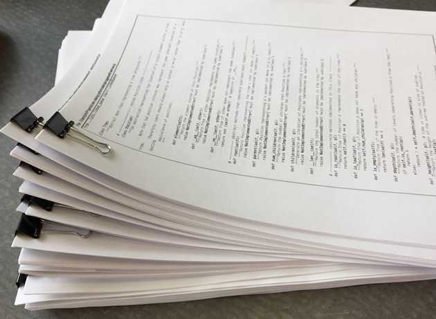 A stack of algorithms, printed out for review